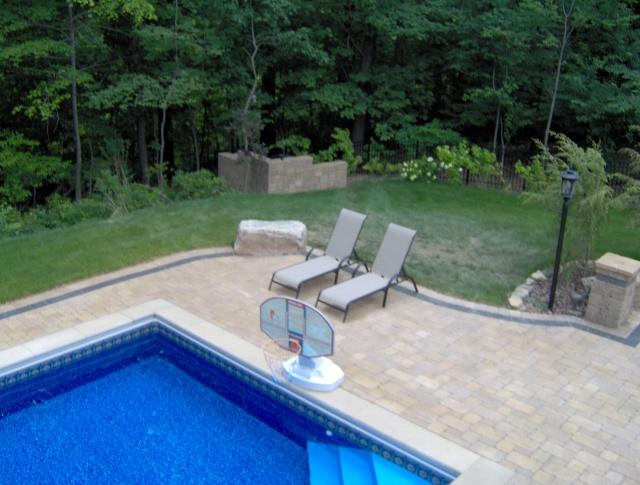 stone around pool | arlene designs